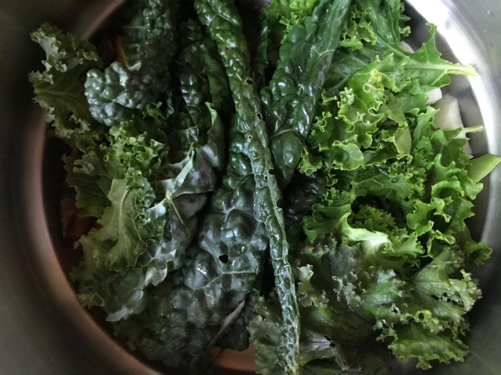 kale leaves in a steamer pot