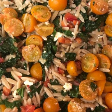 Orzo salad with kale, feta cheese and golden cherry tomatoes
