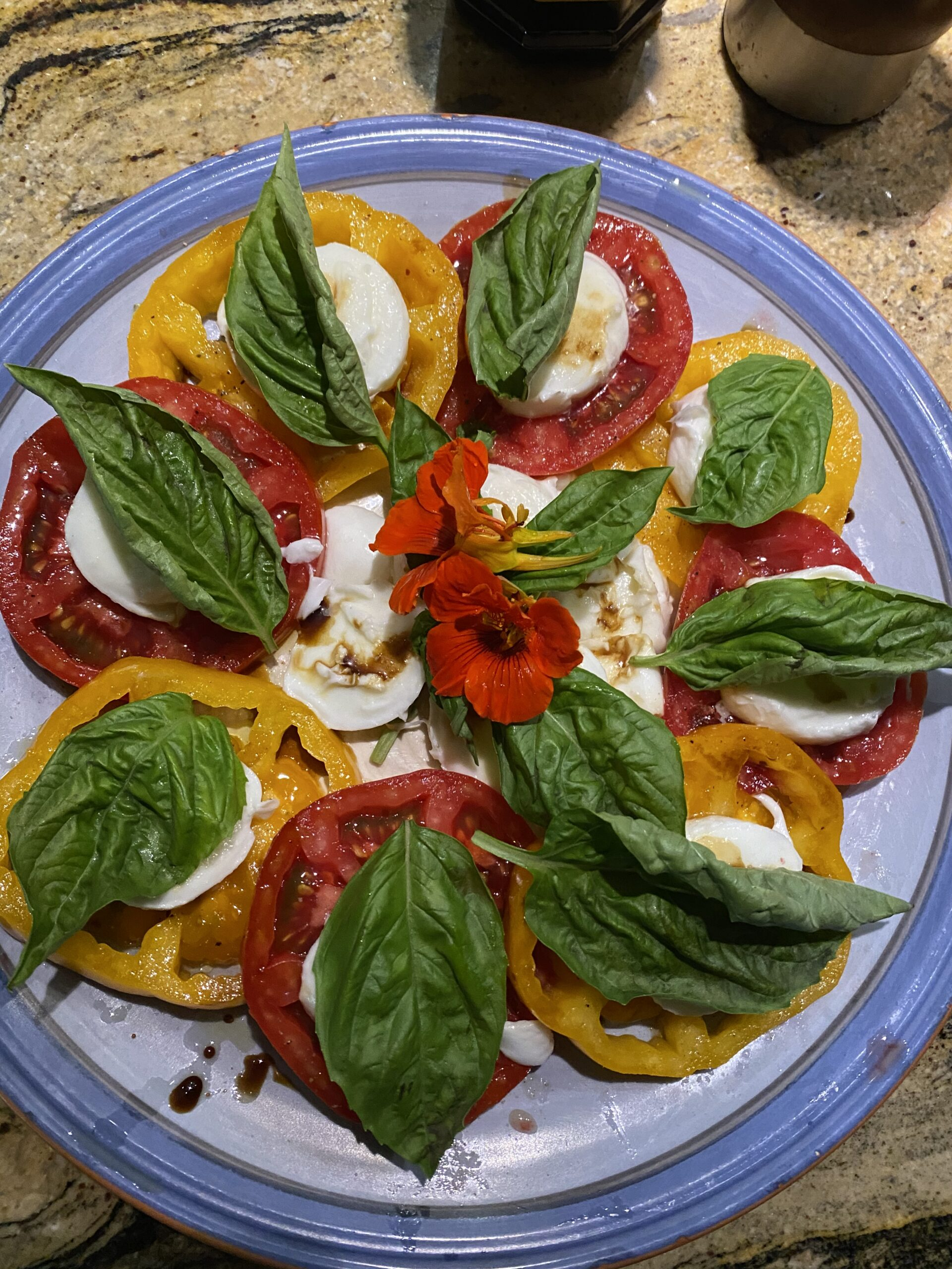 Plate of tomatoes caprese